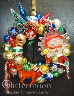 All things Christmas collide to make a fun, fabulous paean to joy. With a large Santa celluloid and tin tree topper dominating, the fun never ends. $285 ** SOLD **