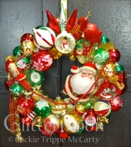 A HO HO HO of a wreath in traditional reds & greens with a big jolly Santa as centerpiece, joined by a marvelous little Japan Belsnickel, and so much more! $250 ** SOLD**
