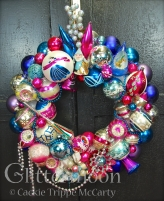 For you deep pink and blue lovers here is a gorgeous wreath packed with so much terrific stuff. Notice the sly look that adorable (but mischievous) elf is casting at the Christmas Princess on the jumbo Poland ball next door. $285 ** SOLD **