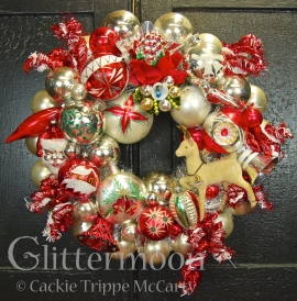 "Red and white dominate to create a peppermint colored wreath of sweetest proportions. 17"" diameter. $225 ** SOLD **"