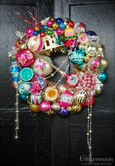 """PINK PIXIE Pinks and other delights make for a bright wreath. Featuring lots of fabulous ornaments for your Christmas pleasure. 17"""" $265 *SOLD*"""
