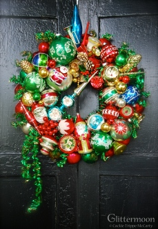 """SANTA'S NOEL Tradiontal Christmas colors collide with some marvelous old glass Santas. 17"""" $225 ** SOLD **"""