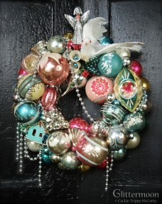 """WINGS OF A DOVE Shabby colors delight in this little wreath. Topped with a dove. 15"""" $165 *SOLD*"""