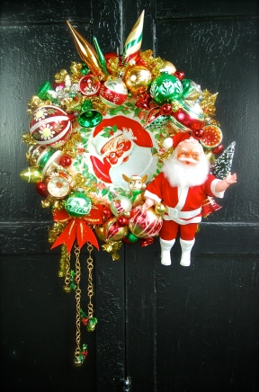 """Cookie Time. With a centerpiece consisting of an old cookie plate, flanked with a big Santa and lots of colorful holiday cheer. 17"""" diameter *SOLD*"""