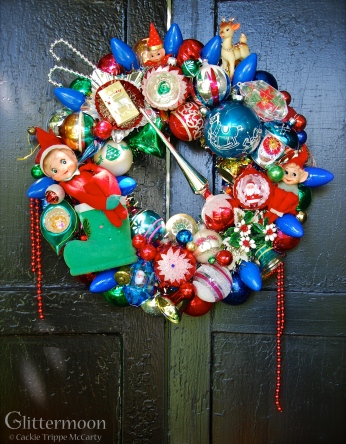 """ELF MAGIC. For the Mid-century kids, so many happy memories rolled into this wreath studded with elves and old C9 bulbs galore. 17"""" diameter $245 SOLD"""