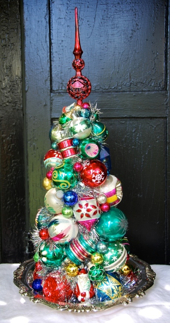 """HOLIDAY INN. A lovely, multi-colored topiary centerpiece on a vintage silverplate serving piece. 24 1/2"""" tall. $250 *SOLD*"""