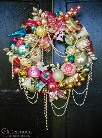 """PINK PEARL. A dreamy, girly wreath of pastel pinks with soft blue and creamy white accents. Draped with pearls for true romance. 17"""" diameter $250 SOLD"""