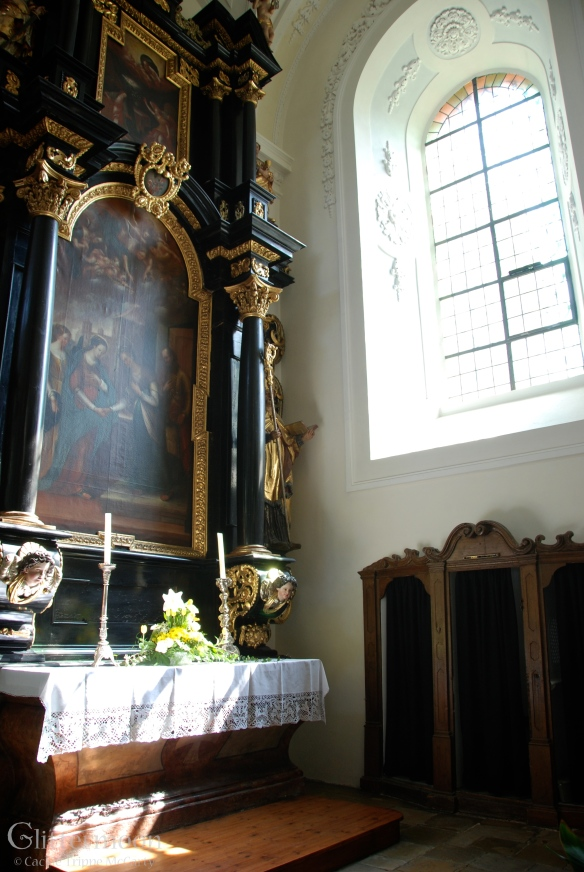 A side altar in a serene  church in Passau, Germany.