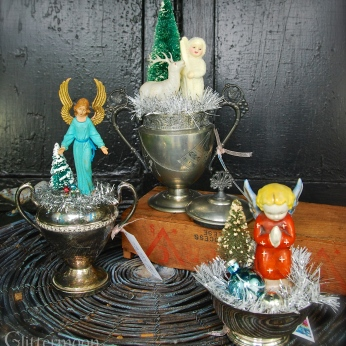 An angelic mood prevails with the little topes but there is a charming snow baby, too, in a Victorian sugar bowl