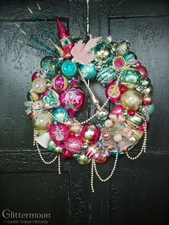 """Pink Dove: A shabby chic pink dove on top, a jumbo magenta Poland teardrop, and other lovelies set in a pastel wreath of pale teals and pinks. Approx 17"""" $265 *SOLD*"""