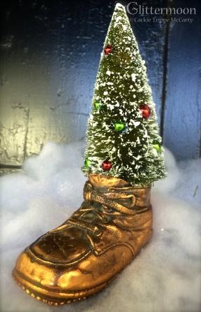 Bottlebrush tree in an old copper baby shoe $22