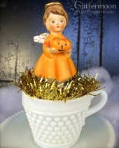 October angel in a milk glass cup&saucer $36