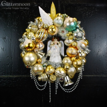Angel Glow Wreath. Lovely soft golds, silvers, and whites surround a working vintage Noma angel tree topper. She emits a pretty soft glow when plugged in! $265 with storage bag