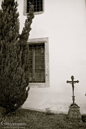 One Cross. A solitary but beautifully ornamental cross in a cemetery in Salzburg, Austria.