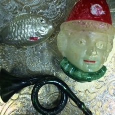 A cool old silver fish, joker (or clown)head and a French horn