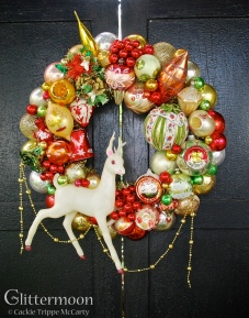 """Christmas Tapestry - A stunning and unique color palette plus some huge pieces make this one a real showstopper. The reindeer alone is too, too much. Oh, and check out that big tapestry ball - wow. Approx 25"""" tall (including garland) by 19"""" wide - about 20"""" diameter $295 *SOLD*"""