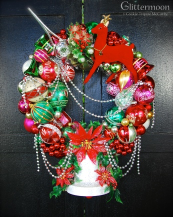 """Ding Dong Bell - this one makes a big statement in reds and greens and has a fabulous vintage poinsettia bell on the bottom that is really a music box. Pull the cord and hear """"Silent Night."""" About 18"""" diameter and 25"""" tall. $275 *SOLD*"""
