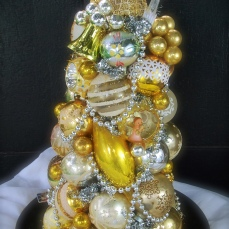 "Golden Halo Topiary Centerpiece - A mostly gold centerpiece perfect for any holiday table. With different views on every side and a charming angel on top. $225 Approx 19"" tall - Base 12"""