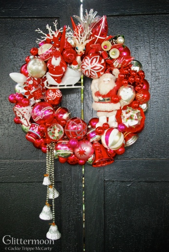 """It's Red Wreath - If you love red then this is for you! With wonderful vintage Santas, a very old set of bells dripping from the lower left, and other vintage goodies. 26"""" tall - including tail - 15"""" across - approx. 16"""" diameter $245 *SOLD*"""